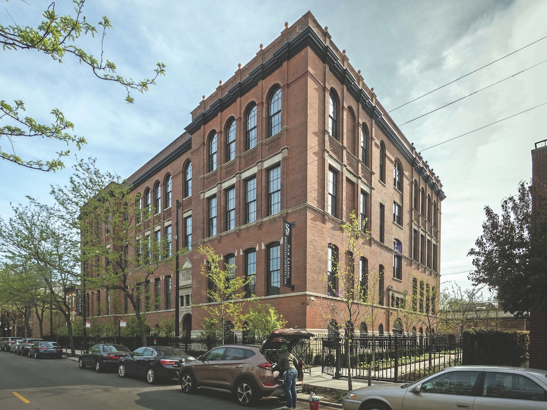Mulligan School Apartments occupy a 25,000-sf lot between Sheffield Avenue and the CTA elevated line