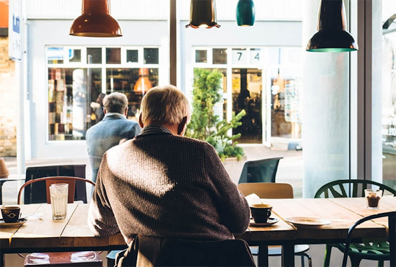 A man sits in a cafe