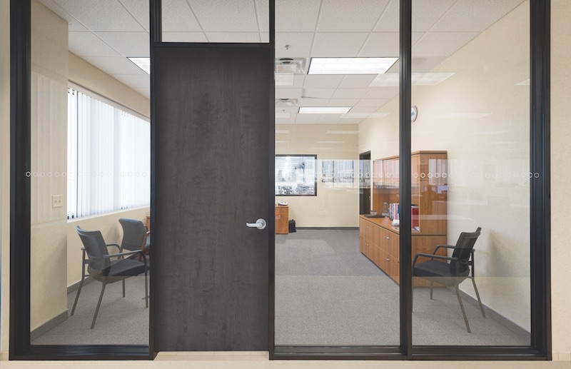 A double-glazed, demountable interior office partition system