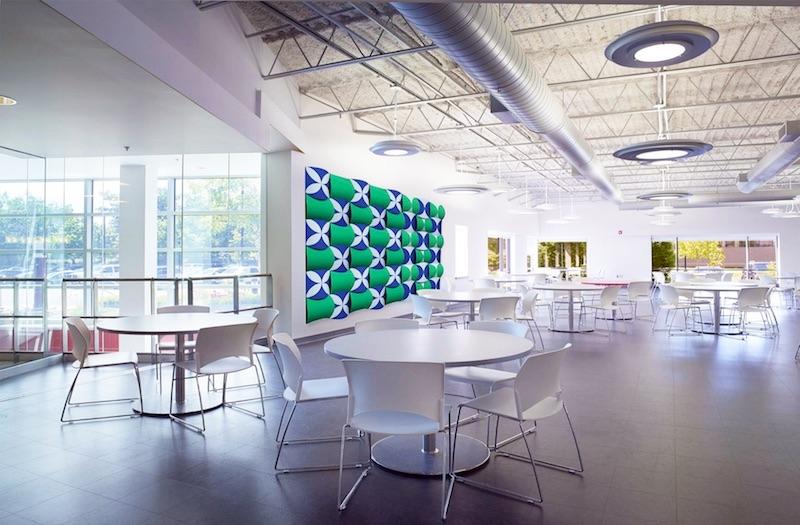 An E Ink wall highlights an open work space