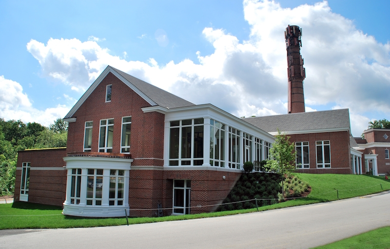 The exterior of the Rachel Carson Music and Campus Center, with the 19th century smokestack visible.