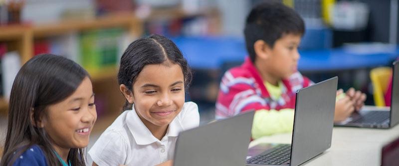 Children working on laptops