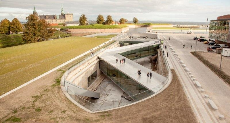 A series of three double-level bridges spans the dry dock, serving both as an ur