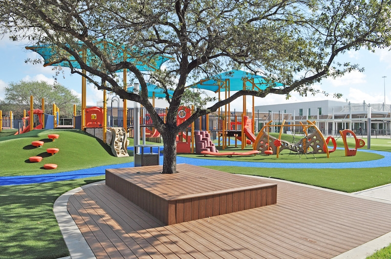 ​View from classrooms (Building A) to learning platforms and play area at the Awty International School in Houston