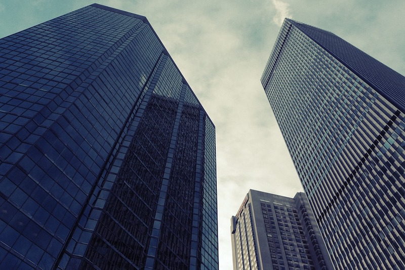 Three high-rise buildings as seen from the ground