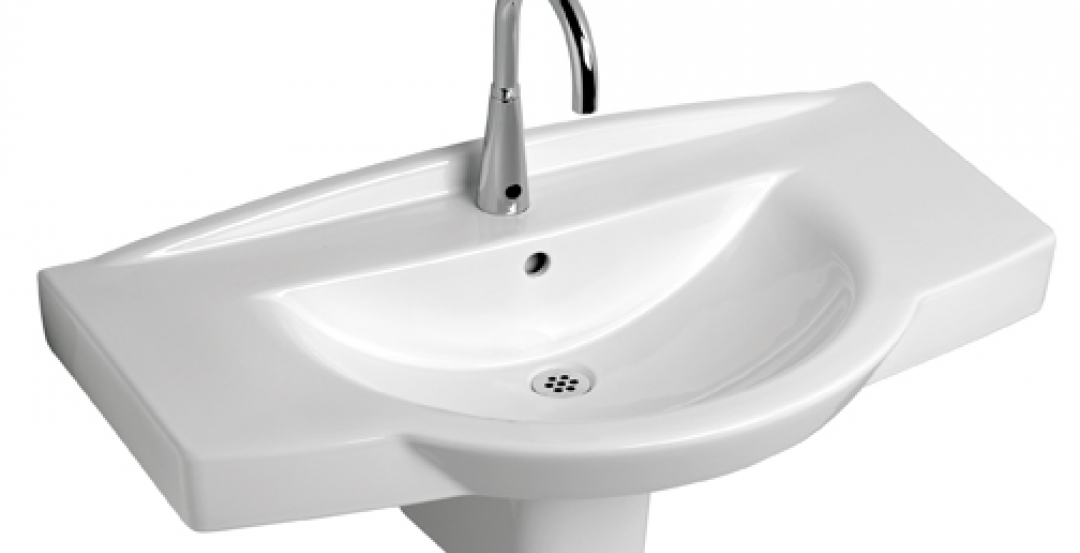 Sensor-operated faucets, such as this wall-hung, ADA-compliant model, help impro