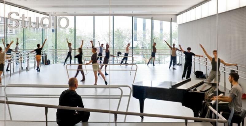 New glass walls make dancers at the Glorya Kaufman Dance Studio visible to neigh