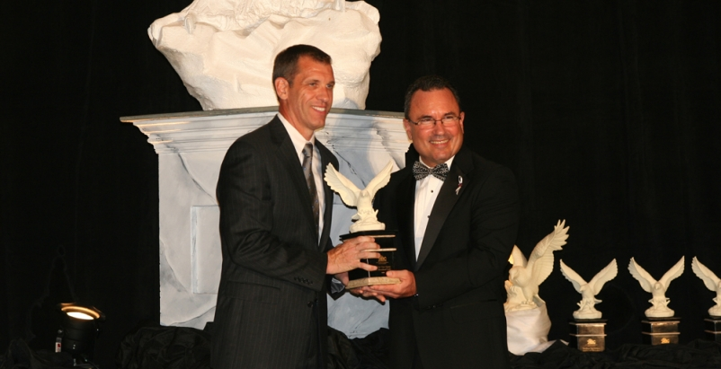 Dwyn Taylor (eft), Vice President of Stellar, accepts an award at the ABC ceremo