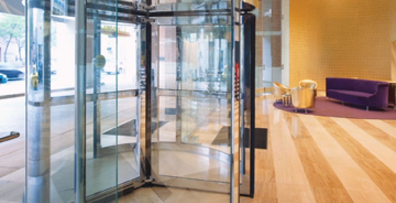 An automatic revolving door (DORMA 1000-A Series) installed at Detroits Greekto