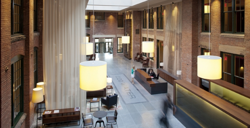 Formerly an open-air courtyard, the two-story grand lobby is now the centerpiece