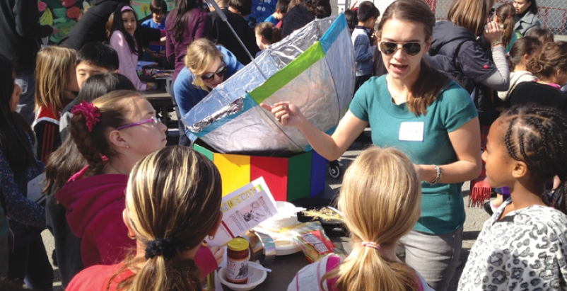 A Cal Poly Pomona student helps children at Santa Monicas McKinley Elementary S