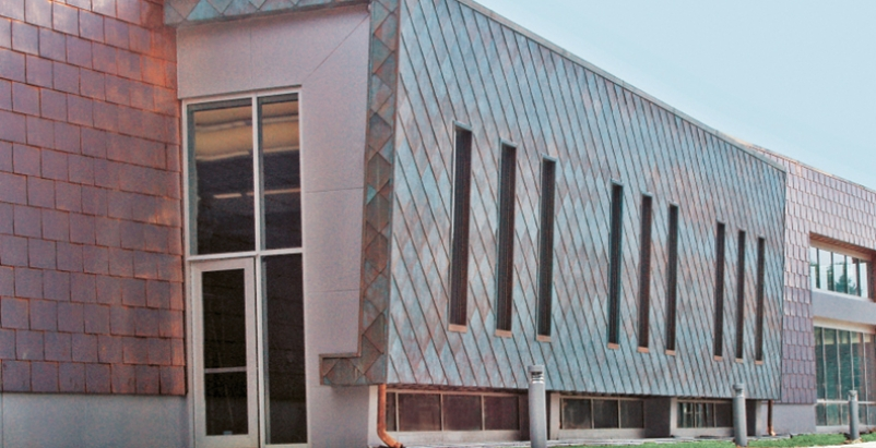 Moline public library uses copper as an exterior building for Exterior building products