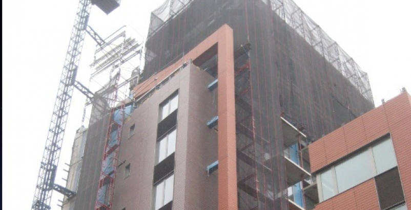 Installation of a facade panel system that uses a rainscreen approach to control