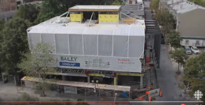 Multifamily building in downtown Montreal is being built from the roof down