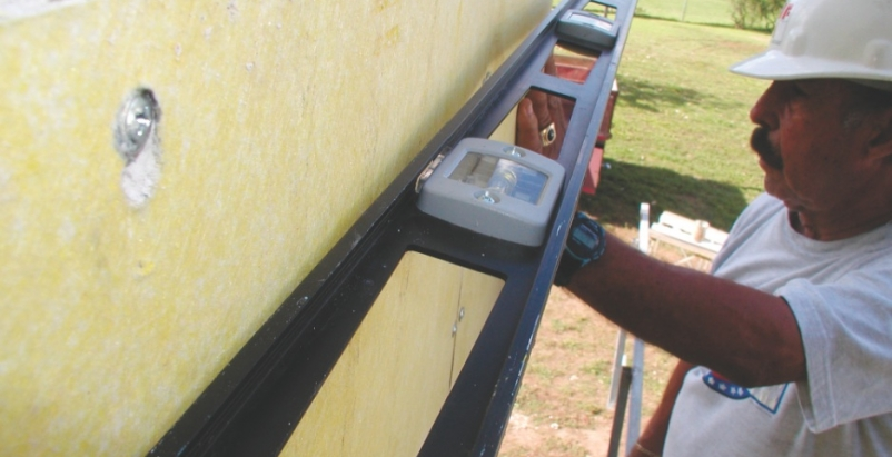 To true the wall surface, the installer should level the insulation board, rathe