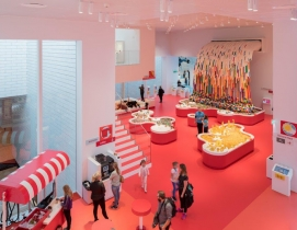 A red room in the LEGO House with a LEGO waterfall