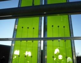 "Algae ""farms"" sandwiched between glass faade panels."