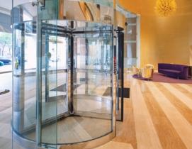 An automatic revolving door (DORMA 1000-A Series) installed at Detroits Greekto
