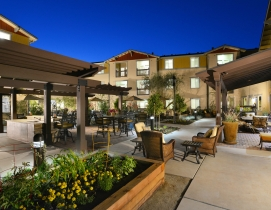 Outdoor amenities include a patio area with a BBQ center, relaxing fountain and