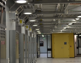 By utilizing the 415/240 V AC power distribution system, which is standard in mo