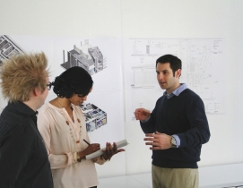 Jared Krieger (right) conducts a project coordination meeting with two of his Ge