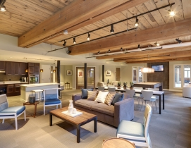 A pool table, tables, and chairs in a communal space at Loft Five50
