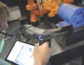 A handheld scanner being used