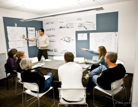 A project undergoes design review at MHTN Architects, a 65-member firm based in