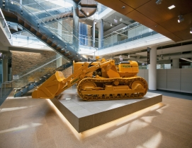 A 1953 Allis-Chalmers bulldozer in the central atrium of the Walsh Training and