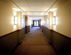 Rooms lining a hotel hallway
