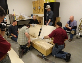 Technical Academy instructor Marc Ilgenfritz, center facing, invites installers