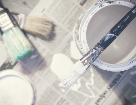 A paint can and three brushes