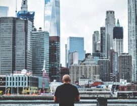 A man standing in front of the New York City skyline